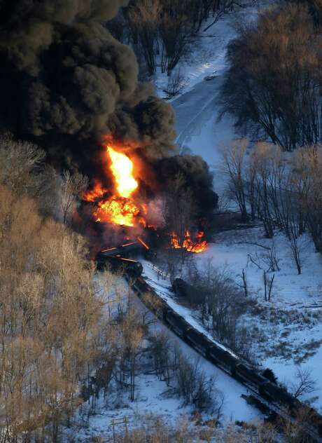 Smoke and flames erupt from the scene of a train derailment Thursday near Galena, Ill. A BNSF Railway freight train loaded with crude oil left the tracks in a rural area where the Galena River meets the Mississippi. Photo: Mike Burley, MBO / Telegraph Herald