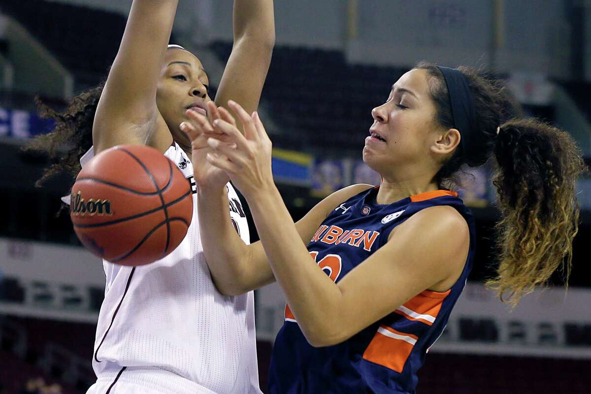 Auburn's Jessica Jones, right, loses the ball as she is pressured by A&M's Rachel Mitchell during the Aggies' victory in the SEC tournament.