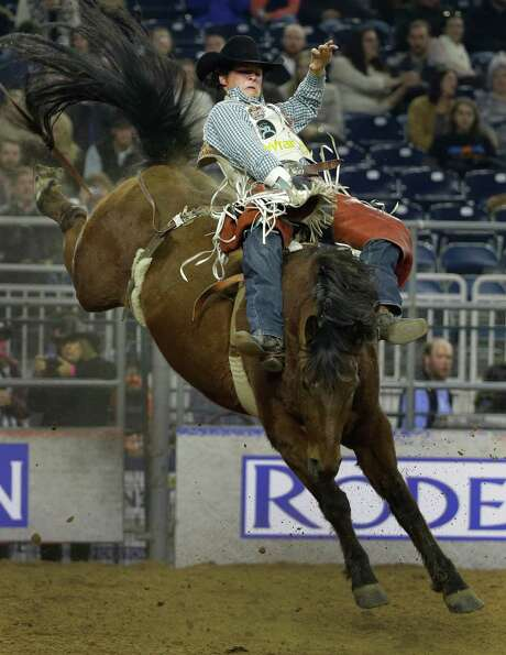 Before riding bareback, Champion competed in both bull riding and mounted shooting. Photo: Melissa Phillip, Houston Chronicle / © 2014  Houston Chronicle