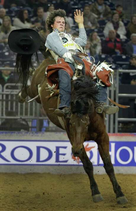 """""""You can't think and ride,"""" Champion says. """"You just have to react, and that's the biggest thing, is letting yourself do that."""" Photo: Melissa Phillip, Houston Chronicle / © 2014  Houston Chronicle"""