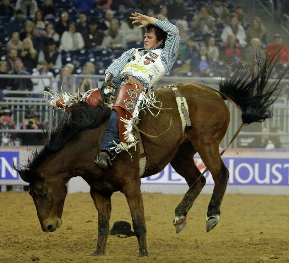 Champion, who grew up in The Woodlands, didn't begin riding bareback until his senior year of high school. Now at 24, he's one of the top riders in the world. Photo: Melissa Phillip, Houston Chronicle / © 2014  Houston Chronicle