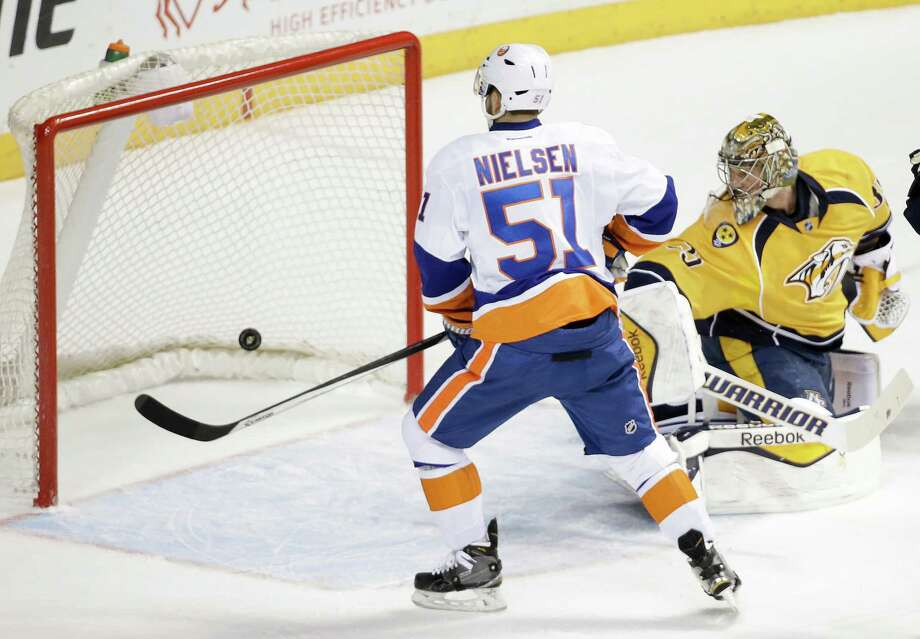 New York Islanders center Frans Nielsen (51), of Denmark, watches as a shot by teammate Anders Lee, not shown, gets past Nashville Predators goalie Pekka Rinne, right, of Finland, for a goal in the first period of an NHL hockey game Thursday, March 5, 2015, in Nashville, Tenn. (AP Photo/Mark Humphrey) ORG XMIT: TNMH112 Photo: Mark Humphrey / AP