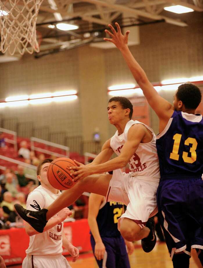Scotia-Glenville's Sean Degraffenreid (23) scores while being defended by Amsterdam's Jemal Robinson (13) during their Section II Class A Boys' Semifinal High School Basketball game in Guilderland, N.Y., Thursday, March 5, 2015. (Hans Pennink / Special to the Times Union) ORG XMIT: HP122 Photo: Hans Pennink / 00030842A