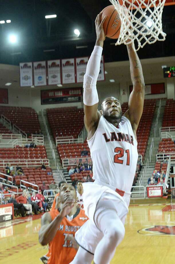 Lamar's Donovan Ross gets past Sam Houston State's defense as he drives into the basket during the men's match-up at the Montagne Center Thursday.  Photo taken Thursday, March 5, 2015  Kim Brent/The Enterprise Photo: Kim Brent / Beaumont Enterprise