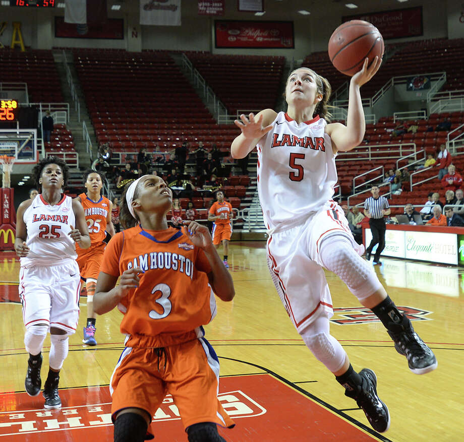 Lamar's Baileigh O'Dell shoots for 2 points past Sam Houston State's Shernise Robertson during the women's match-up at the Montagne Center Thursday. Photo taken Thursday, March 5, 2015 Kim Brent/The Enterprise Photo: Kim Brent / Beaumont Enterprise