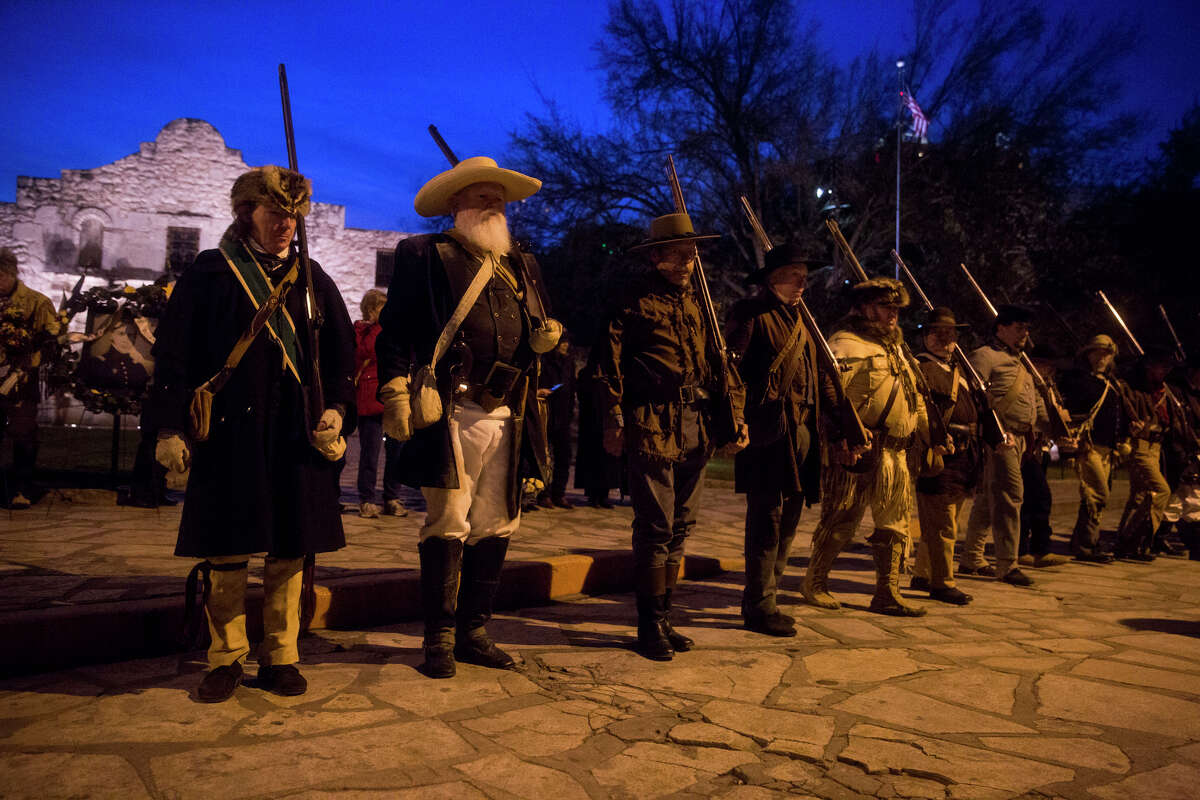 Historical reenactors from all over Texas and the U.S. walk in formation during the annual Dawn at the Alamo ceremony in San Antonio, TX on Friday, March 6, 2015. This year marks the 179th anniversary of the predawn battle. The reenactors were brought to the ceremony by the San Antonio Living History Association.