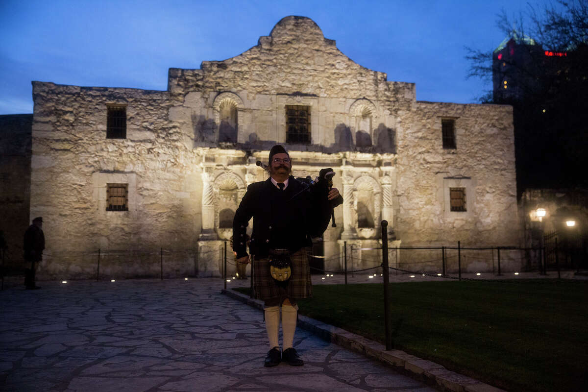David Sutherland stands at attention after playing the bagpipe during the annual Dawn at the Alamo ceremony in San Antonio, TX on Friday, March 6, 2015. This year marks the 179th anniversary of the predawn battle.