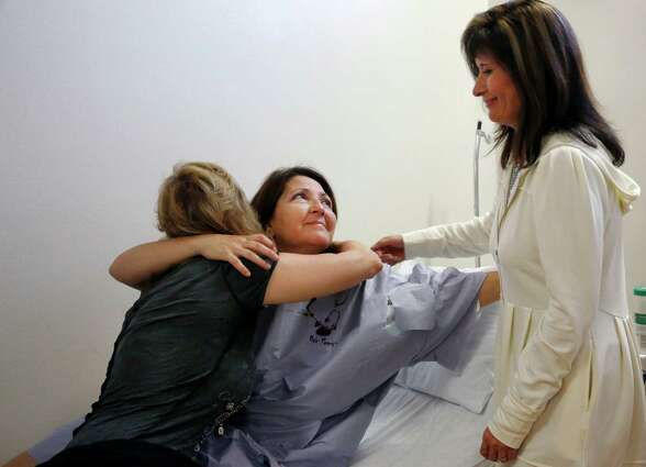 Zully Broussard, center, embraces longtime friends Danielle Duhe, left, and Pam Nelson before going into her kidney donation surgery which kicked off the largest single center kidney paired donation chain on the West Coast at California Pacific Medical Center March 5, 2015 in San Francisco, Calif.