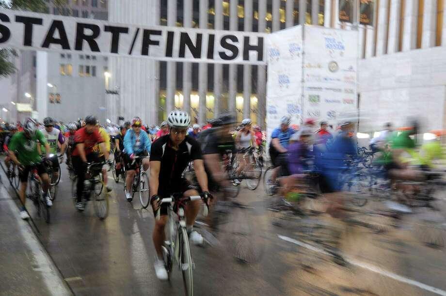 A group of cyclists begin the 2014  Tour de Houston bike ride downtown. (Dave Rossman photo) Photo: Dave Rossman, Freelance / Freelance
