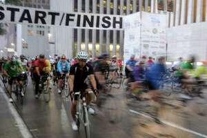 A group of cyclists begin the 2014  Tour de Houston bike ride downtown. (Dave Rossman photo)