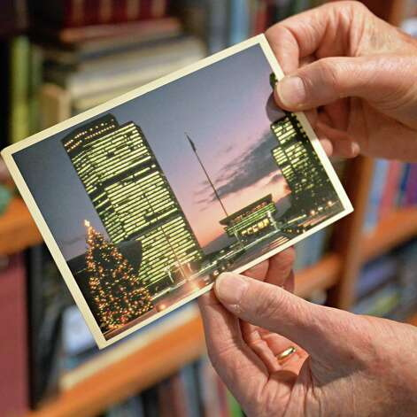 Robert Drew, a deltiologist or postcard collector, holds a postcard of the Empire State Plaza Friday Dec. 5, 2014, in Albany, NY. (John Carl D'Annibale / Times Union) ORG XMIT: ALB1412051630346968 Photo: John Carl D'Annibale / 00029763A