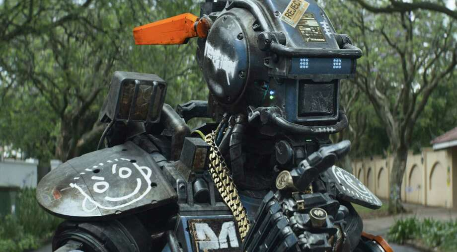 """Chappie is a member of a robotic police force in """"Chappie."""" Photo: Columbia Pictures, HONS / Columbia Pictures"""