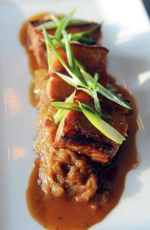 Pork belly over Bavarian kraut at The Flammerie on Wednesday Feb. 25, 2015 in Kinderhook, N.Y. (Michael P. Farrell/Times Union) Photo: Michael P. Farrell / 00030744A