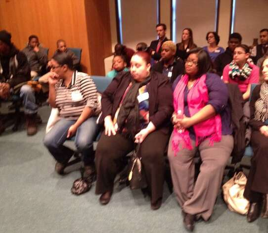 Brighter Choice charter school parents and students listen as the SUNY Charter School committee meets Friday, March 6, 2015, in Albany, NY. (John Carl D'Annibale/Times Union)