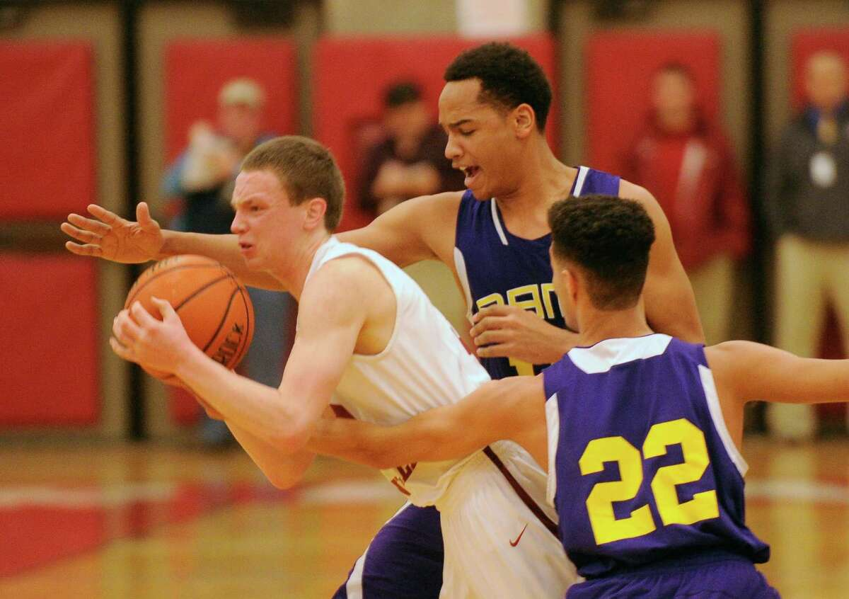 Scotia-Glenville's Scott Stopera (3) is defended by Amsterdam players during their Section II Class A Boys' Semifinal High School Basketball game in Guilderland, N.Y., Thursday, March 5, 2015. (Hans Pennink / Special to the Times Union) ORG XMIT: HP119