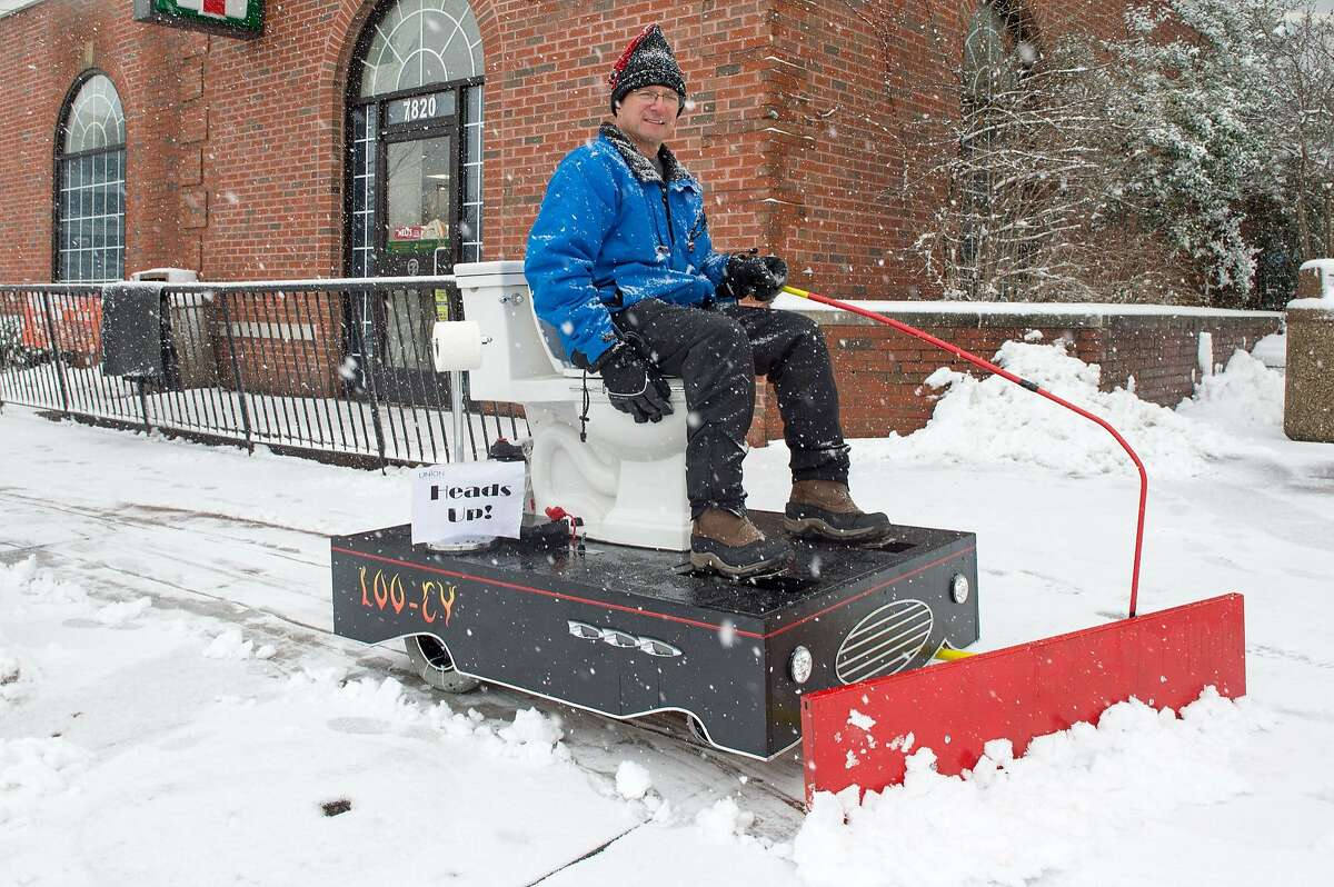 THIS A JOB FOR COMMODE MAN: Hardware store owner David Goldberg never has to stop for a bathroom break while he's plowing snow in Bethesda, Md. The home-made plow is an electric hybrid.
