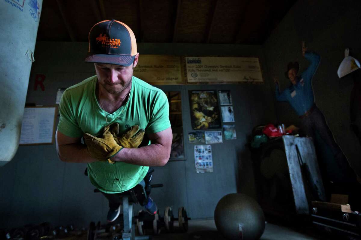Champion bareback cowboy Clint Cannon trains in a space he has prepared outside his home. Cannon strongly believes that the success of competitors in the rodeo industry as well as their ability to heal from injuries depends on how fit they are. Thursday, March 5, 2015, in Waller.