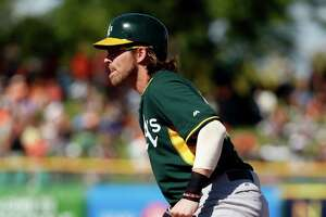 Josh Reddick scratched from A's lineup with oblique strain - Photo