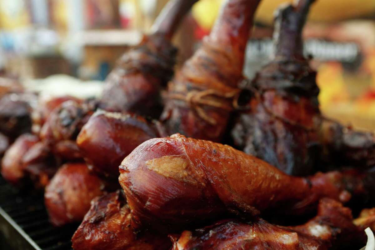 Bacon-wrapped turkey legs are seen at the Houston Livestock Show and Rodeo Tuesday, March 3, 2015, in Houston. ( Jon Shapley / Houston Chronicle )