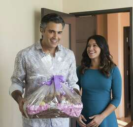 """Mexico-born actor Jaime Camil, left, and Gina Rodriguez star in a comic hit with heart on the CW with """"Jane the Virgin."""""""