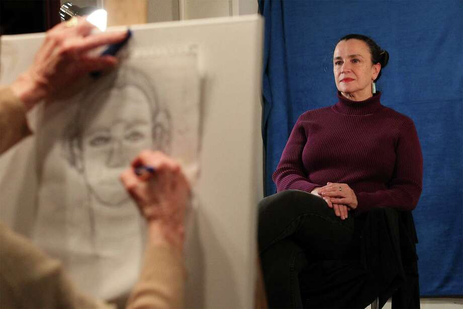 Art model Pamela Kenny poses for students in an oil painting class at Southwest School of Art. Photo: Kin Man Hui /San Antonio Express-News / ©2015 San Antonio Express-News