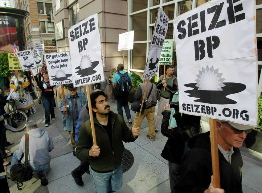 Protesters gather outside of the BP offices in San Francisco on Wednesday, May 12, 2010 to demonstrate against the Gulf oil rig disaster. (AP Photo/Marcio Jose Sanchez)