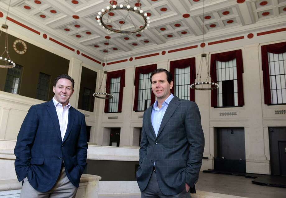 Brandon Hall, left, and Brett Wilderman, principals at Forstone Capital, stand in the former Roberto's Restaurant in the old People's Bank building at the corner of Main and State Steets in downtown Bridgeport.  They have plans for a number of new developments around McLevy Green, including the old bank which will be transformed into a German beer hall. Photo: Autumn Driscoll / Connecticut Post
