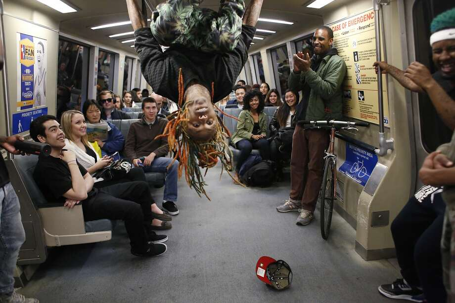 "Member of the Turf Feinz Eric ""eNinga"" Davis, 26, flips head-over-heels during a Turf dance show for an audience on a BART train on Friday Feb. 27, 2015 in San Francisco, Calif. Photo: Mike Kepka, The Chronicle"