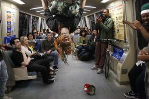 """Member of the Turf Feinz Eric """"eNinga"""" Davis, 26, flips head-over-heels during a Turf dance show for an audience on a BART train on Friday Feb. 27, 2015 in San Francisco, Calif."""