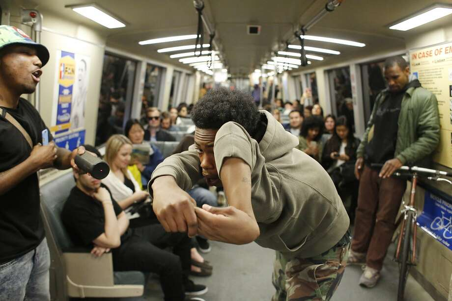 "Member of the Turf Feinz Dimonte ""Bad"" Lacy, 16, shows off his ""bone breaking"" moves during a performance for an audience on a BART train on Friday Feb. 27, 2015 in San Francisco, Calif. Photo: Mike Kepka, The Chronicle"