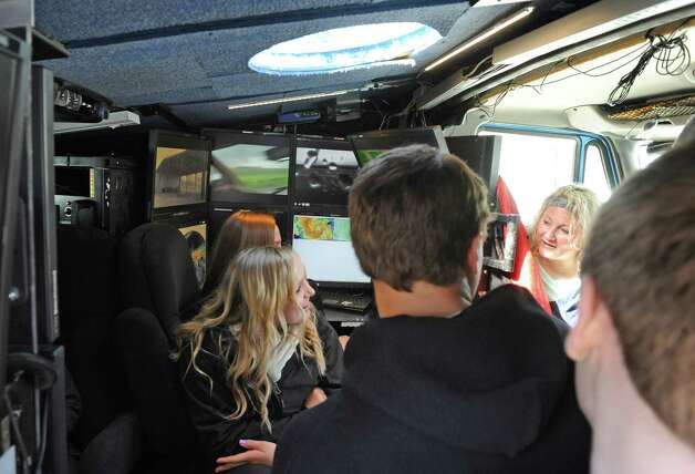 Meteorologist Alycia Gilliland, right, with the Center for Severe Weather Research, shows off the interior of the Doppler on Wheels to Burnt Hills-Ballston Lake High School students on Friday, March 6, 2015, in Burnt Hills, N.Y.  (Michael P. Farrell/Times Union) Photo: Michael P. Farrell / 10030874A