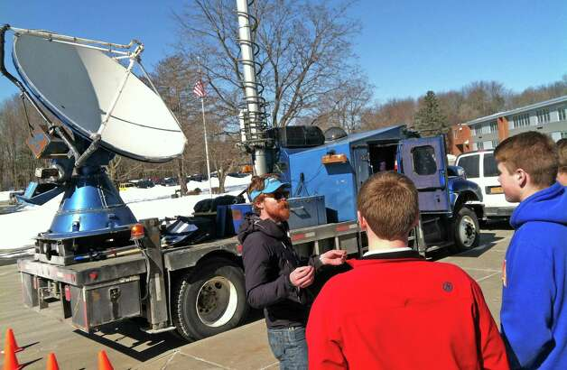 Meteorologist Traeger Meyer, center, with the Center for Severe Weather Research explains the Doppler on Wheels to Burnt Hills-Ballston Lake High School students on Friday, March 6, 2015, in Burnt Hills, N.Y.  (Michael P. Farrell/Times Union) Photo: Michael P. Farrell / 10030874A