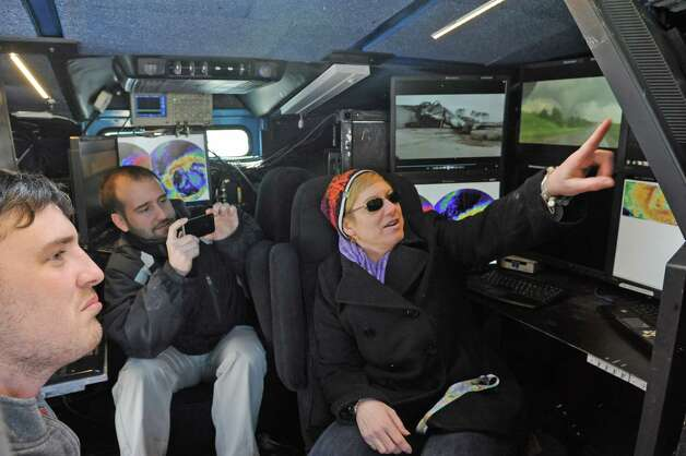 Burnt Hills chemistry and research teacher Regina Reals, right, tours the Center for Severe Weather Research Doppler on Wheels as it visted  Burnt Hills-Ballston Lake High School on Friday, March 6, 2015, in Burnt Hills, N.Y.  (Michael P. Farrell/Times Union) Photo: Michael P. Farrell / 10030874A