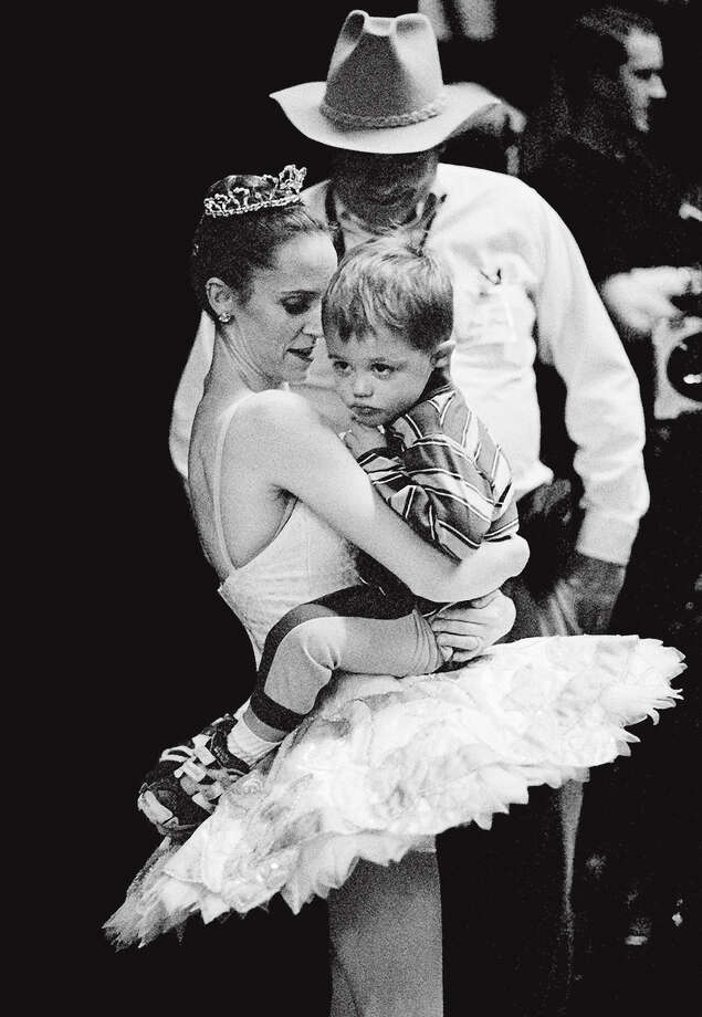 """Tina LeBlanc cuddles son Marinko during a dress rehearsal of """"Nutcracker."""" The photo appears in """"Balancing Acts"""" (Princeton Architectural Press), for which photographer Lucy Gray followed three ballerina mothers over the course of 15 years. Photo: Lucy Gray / Lucy Gray / ONLINE_YES"""
