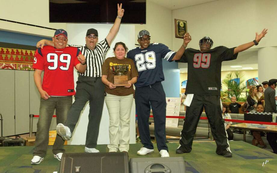 The exuberant crew from the Fort Bend County Sheriffés Department celebrated their win for ébest sauce.é  From left are Homer Gomez, Albert Pedre, Sgt. Audrey Lopez, Gerald Wells, and William Jones. Photo: Photo By Larry Pullen