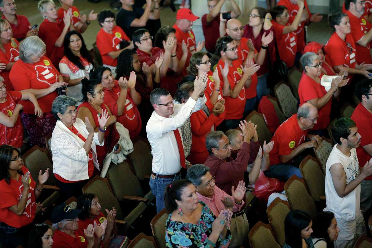 Two bills are aimed at undermining such non-discrimination laws as passed by San Antonio. Supporters celebrate as the city council votes on the ordinance in 2013.