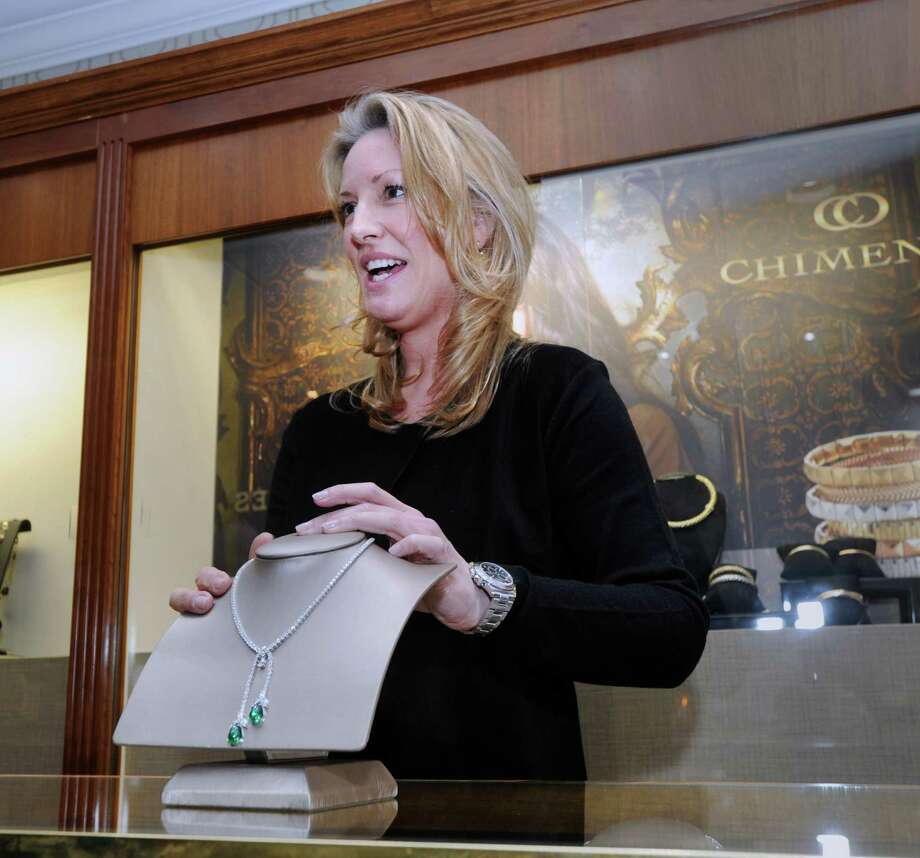 Kimberly La Du with a $220,000 Colombian emerald and diamond necklace inside the new Manfredi Jewelry store at 72 Elm Street in New Canaan, Conn., Friday, March 6, 2015. La Du, a well-known New Canaan jeweler is co-owner of the store with Roberto Chiappellani, who owns the Manfredi Jewelry store in Greenwich.  Chiappellani said the New Canaan store will have its grand opening in mid-April. Photo: Bob Luckey / Greenwich Time