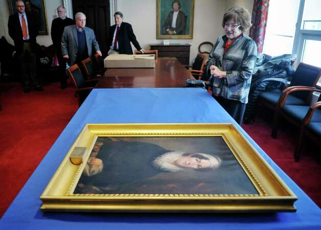 A portrait of Betsey Foot is seen on a table as Louise Marks, right, talks about the painting at the Albany Academy for Girls on Thursday, March 5, 2015, in Albany, N.Y. Marks is an alum of the school and wrote a book on Betsey Foot. The painting seen on table is on display at the school. (Paul Buckowski / Times Union) Photo: PAUL BUCKOWSKI / 10030889A