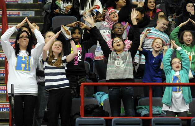 Hackett Middle School english teacher Meghan Vacca, left, dances with her students to tHe Village People's YMCA during a break in action of the Quinnipiac vs Monmouth Women's MAAC Championship quarterfinals game at the Times Union Center on Friday March 6, 2015 in Albany, N.Y.  (Michael P. Farrell/Times Union) Photo: Michael P. Farrell / 10030866A