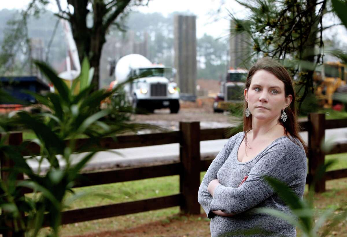 Lindsey Michalak Kindall stands in front of her home along the 4100 block of Lonesome Pine Road where the Grand Parkway is being constructed. She desperately wants a sound wall, but the builders say it's too late.