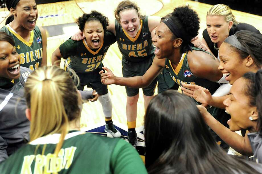 Siena women's basketball team celebrates its 71-61 win over Iona in their quarterfinal game in the MAAC Championship on Friday, March 6, 2015, at Times Union Center in Albany, N.Y. (Cindy Schultz / Times Union) Photo: Cindy Schultz / 10030865A