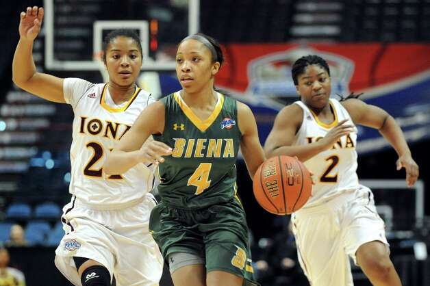 Siena's Emia Willingham, center, drives up court as Iona's Aaliyah Robinson, left, and Aurelli Cammock defend during their quarterfinal game against Iona in the MAAC Championship on Friday, March 6, 2015, at Times Union Center in Albany, N.Y. (Cindy Schultz / Times Union) Photo: Cindy Schultz / 10030865A