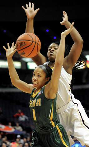 Siena's Emia Willingham, left, loses control as Iona's Aurelli Cammock defends during their quarterfinal game in the MAAC Championship on Friday, March 6, 2015, at Times Union Center in Albany, N.Y. (Cindy Schultz / Times Union) Photo: Cindy Schultz / 10030865A