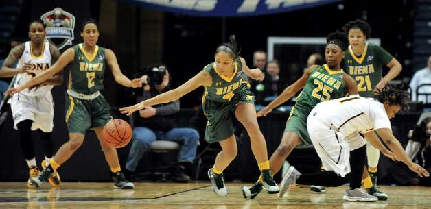 Siena's Emia Willingham, center, steals the ball during their quarterfinal game against Iona in the MAAC Championship on Friday, March 6, 2015, at Times Union Center in Albany, N.Y. (Cindy Schultz / Times Union) Photo: Cindy Schultz / 10030865A