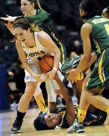 Iona's Marina Lizarazu, left, continues to battle for the ball after the whistle's blown with Siena's Tehresa Coles, bottom, during their quarterfinal game in the MAAC Championship on Friday, March 6, 2015, at Times Union Center in Albany, N.Y. Lizarazu receives a technical foul. (Cindy Schultz / Times Union) Photo: Cindy Schultz / 10030865A
