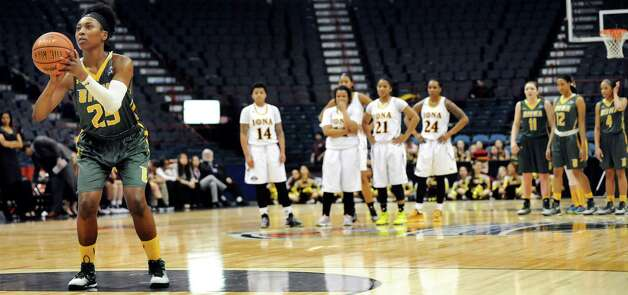 Siena's Tehresa Coles shoots a free throw after drawing a technical foul during their quarterfinal game against Iona in the MAAC Championship on Friday, March 6, 2015, at Times Union Center in Albany, N.Y. (Cindy Schultz / Times Union) Photo: Cindy Schultz / 10030865A