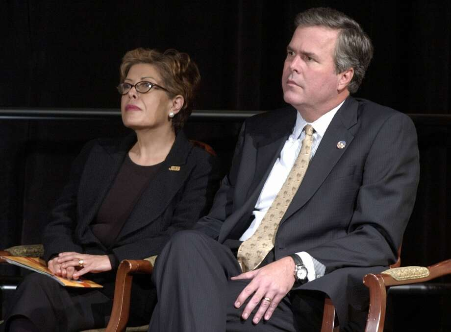 Florida Gov. Jeb Bush and his wife Columba Bush listen to remarks made by first lady Laura Bush during a summit held to promote reading, Tuesday afternoon, Oct. 1, 2002, in Tampa, Fla. (AP Photo/Steve Nesius) Photo: AP