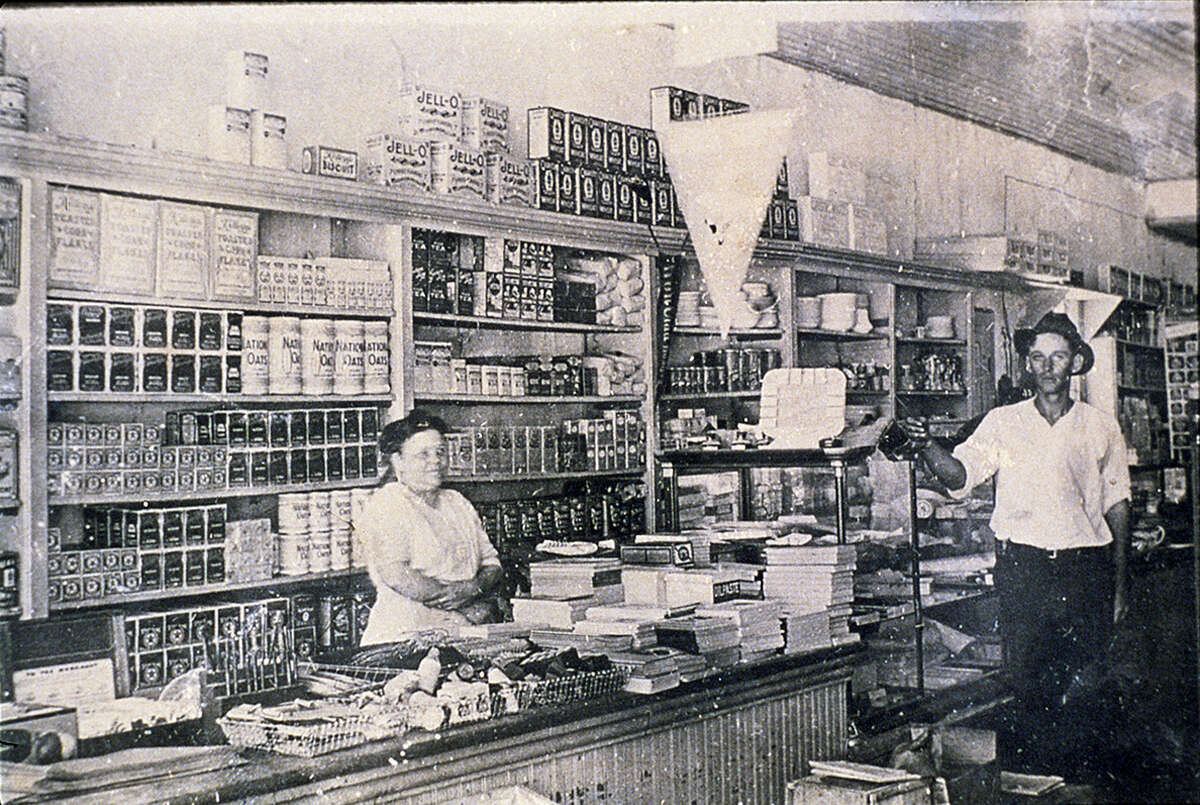 Florence Butt behind the counter of the first-ever H-E-B store, which opened in Kerrville in 1905. The grocer would arrive in San Antonio 40 years later.