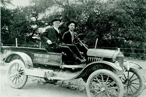 Photo of Howard E. Butt Sr. (left) and G. Leland Richeson in one of C.C. Butt Grocery's first motorized delivery vehicles. The company was a forerunner of today's H-E-B. Richeson, hired in 1913, was one of H-E-B.'s first employees.