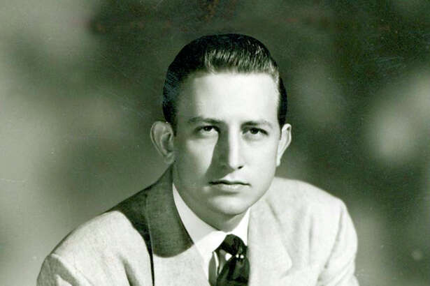 A youthful Howard E. Butt Jr. with a Bible.